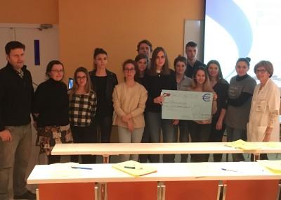 Remise des dons à Mme Dorléan pour la lutte contre le cancer Centre leclerc Dijon